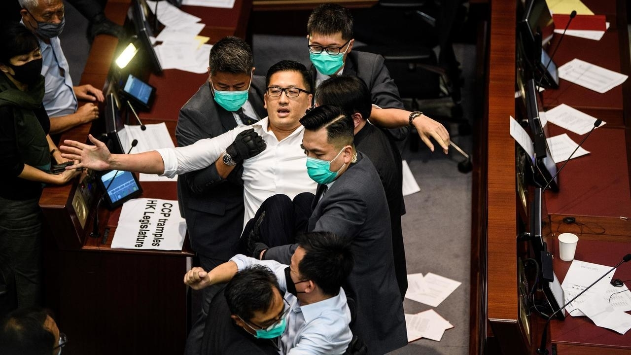 Photo of Police arrest two Hong Kong pro-democracy legislators for alleged roles in 2019 protests