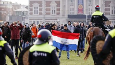 Photo of Amsterdam protests: Huge clashes as police turn water cannons on crowds throwing fireworks